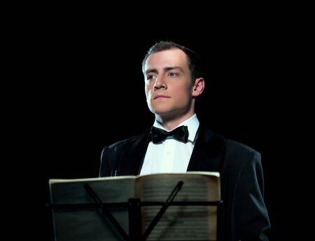 Studio image of young man conducts the orchestra Archivio Fotografico