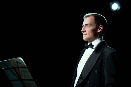 Studio photo of music conductor smiles public