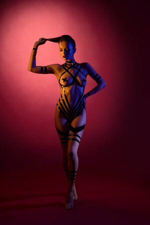 Brunette in the nude with bodyart full-length shot