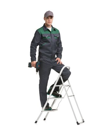 Male in black and green work clothes view