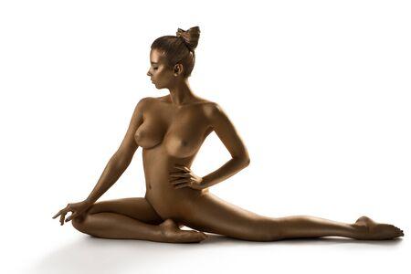 Woman with gold skin art nude portrait in studio