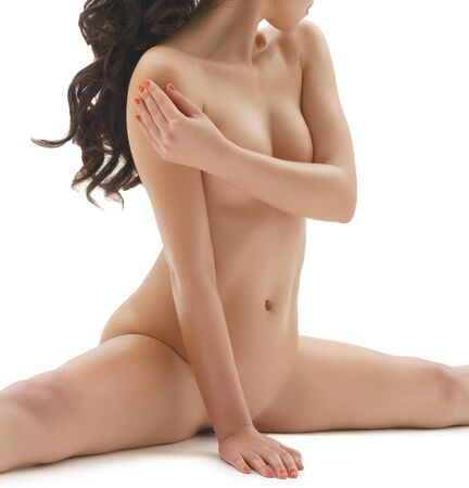 Pretty longhaired brunette shot naked in studio Foto de archivo