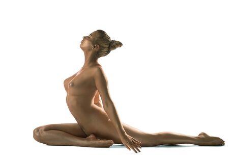 Gold skin woman artistic nude studio portrait Stock Photo