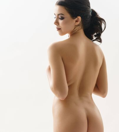 Long haired brunette shot naked view from her back Stok Fotoğraf