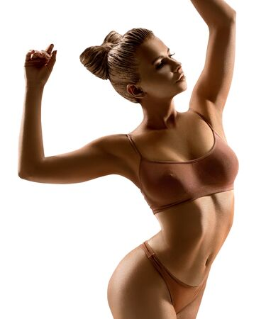 Woman art nude portrait with gold skin in studio