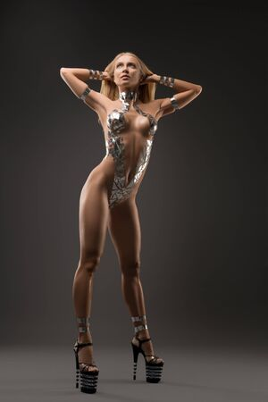 Slim nude blonde with bodyart full-length shot