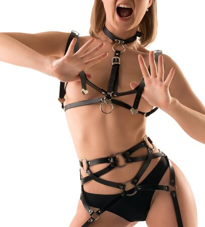 Sexy blonde topless in strings and leather belts