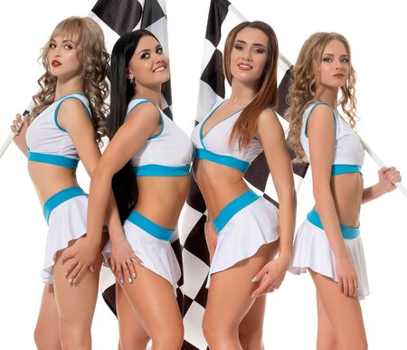 Sexy girls in formula one race style keeping flag Reklamní fotografie