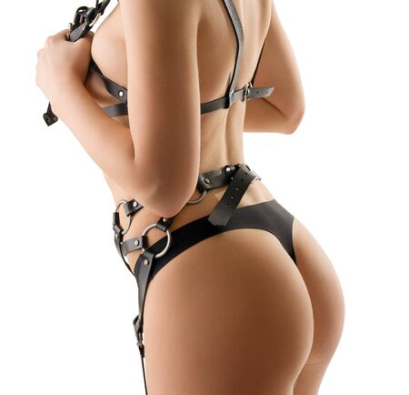 Sexy blonde in black strings and leather belts