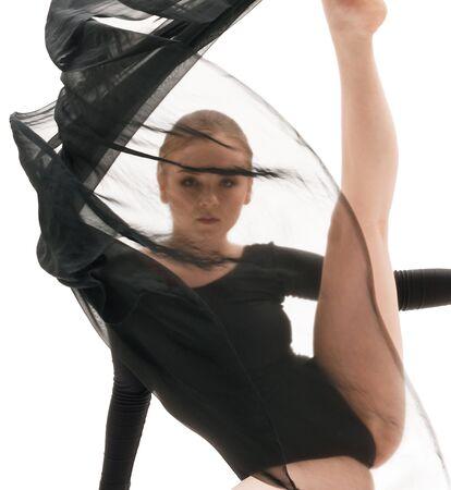 Young pretty gymnast with black cloth studio shot Zdjęcie Seryjne