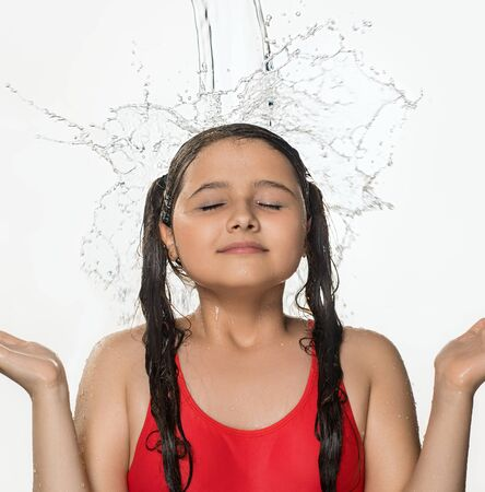 Teenage pretty girl catching water stream from top