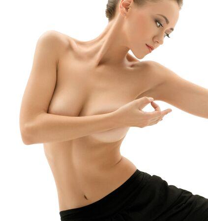 Image of topless woman practising yoga in studio