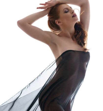 Naked woman gracefully posing with black cloth