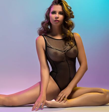 Erotica. Graceful woman dressed in sexy bodysuit