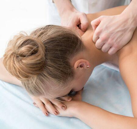 Girl being massaged in spa salon