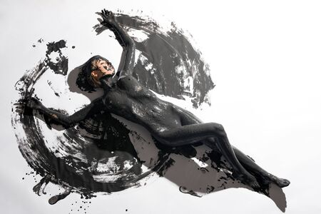 Nude girl in black color paint high angle view 写真素材