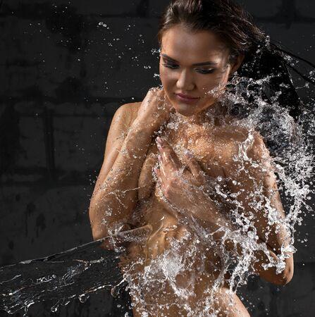 Girl enjoying water stream studio shot Stock Photo