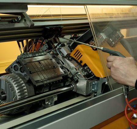 Serviceman setting up the knitting machine shot 스톡 콘텐츠