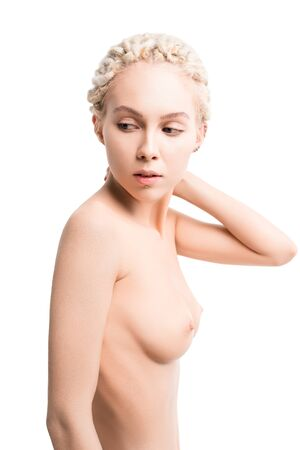 Nude female with trendy hairdo touching neck 写真素材