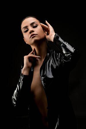 Slim woman in black leather jacket cropped portrait