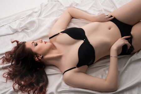 Young brunette in black lingerie high angle view Reklamní fotografie