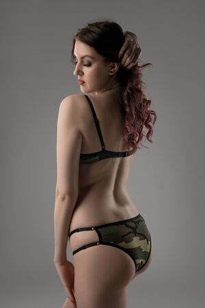 Young brunette in black lace lingerie rearview