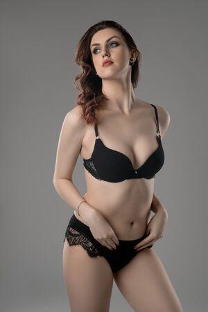 Young brunette in black lace lingerie view Reklamní fotografie