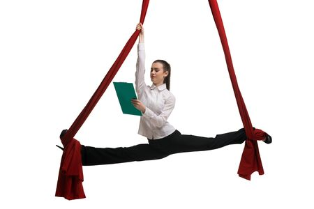 Formal woman on aerial silks reading documents Banco de Imagens