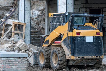 Skid loader working on building construction Stock fotó