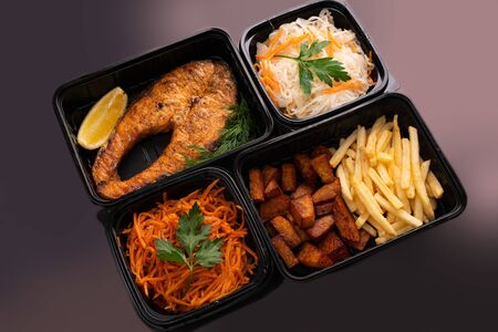 Fish steak with potatoes and vegetables view