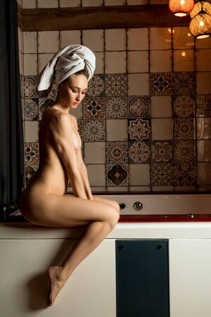 Beautiful girl in sauna shot