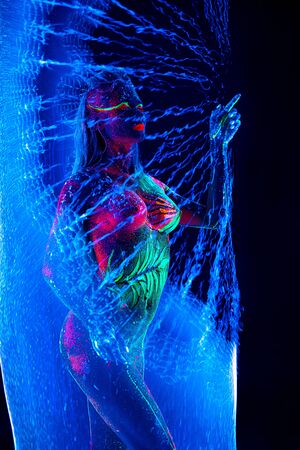 topless Girl with ultraviolet bodyart burst bubble around her Banque d'images