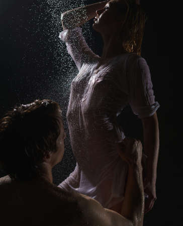 Passionate couple having in shower studio shot