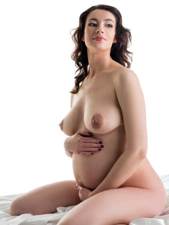 Beautiful expectant mother posing nude in studio