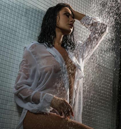 Sexy brunette in wet shot posing in shower