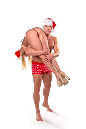 Sexy couple in Xmas costumes having fun