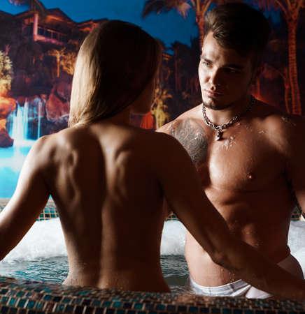Couple enjoying hot tub at hotel