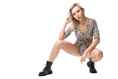 Trendy model in bodysuit and leather boots Banque d'images