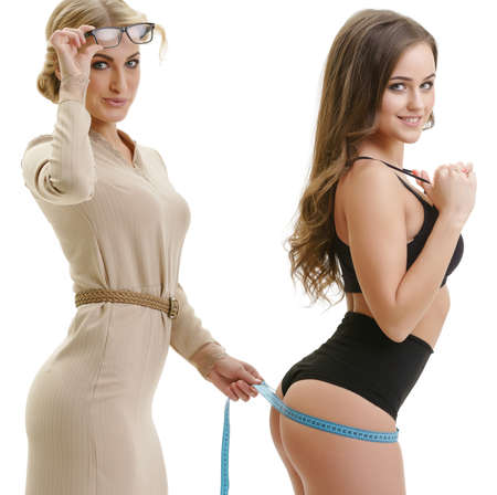 Sexy dressmaker with her pretty client at studio