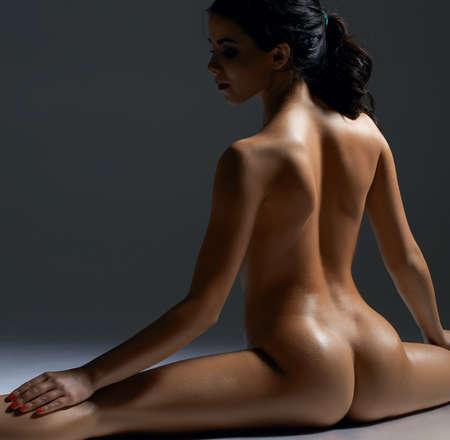 Nude gorgeous brunette portrat in studio