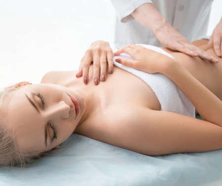 Pretty blonde enjoying massage in saloon Standard-Bild