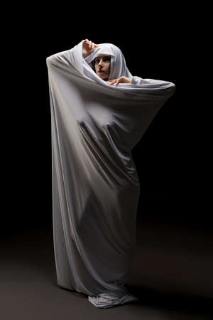 Woman wrapped in cloth other naked body 版權商用圖片
