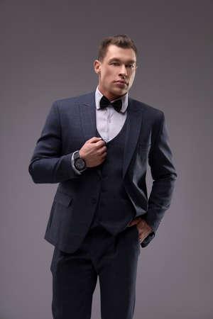 Stylish man in elegant suit in studio Imagens