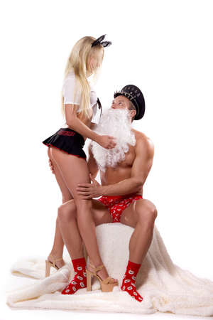 Man in Santa role play with dominance blonde woman