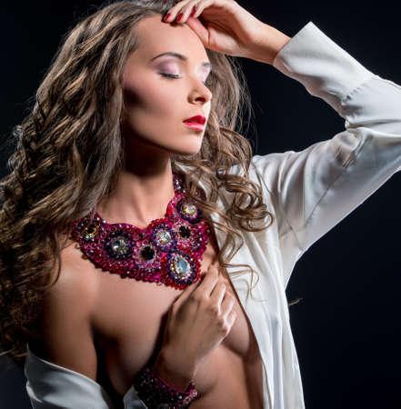 Erotica and glamour. Sensual woman in jewels 版權商用圖片
