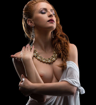 Chic and erotica. Sexy woman dressed in jewelry