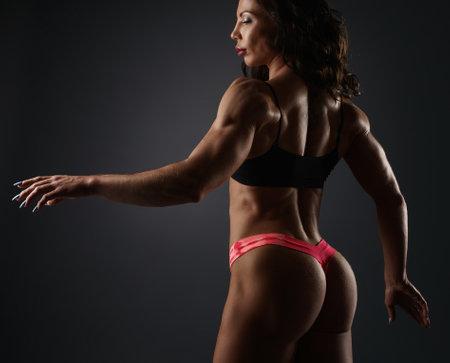 Bodybuilder girl in sport underwear posing
