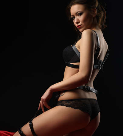 Dominant mistress in black leather lingerie