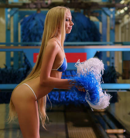 At car wash. Long-haired blonde with pom-poms