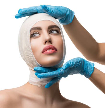 Beautiful woman examined by plastic surgeon
